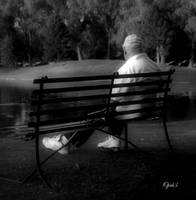man sitting on bench BnW