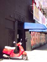 Red Scooter on Sidewalk
