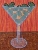 martini glass green olives orange background