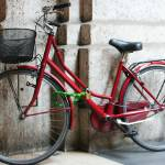 """Red bike in Florence"" by tiffanybrubaker"
