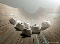 Teapots on curved wood