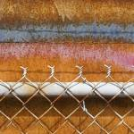 """""""rusty metal plate with spray paint"""" by nathangriffith"""