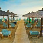 """Deck chairs and beach umbrellas"" by AlexandruVita"