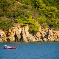 Fishing boat in Skiathos Art Prints & Posters by Alexandru Vita
