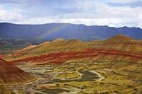 A rainbow forms over Painted Hills