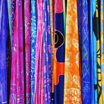 """a rack of sarongs"" by nathangriffith"
