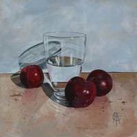 Glass and three plums