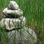 """Stacked Rocks in Grass"" by nate"