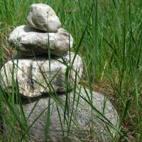 Stacked Rocks in Grass Art Prints & Posters by Nate Jelovich