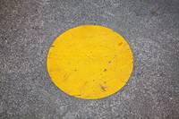 yellow circle painted on park walkway