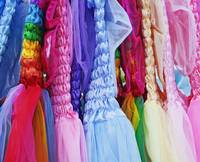rack of tafetta dresses