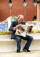 old man reading the newspaper