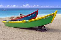 Brightly Painted Fishing Boats on a Caribbean Beac