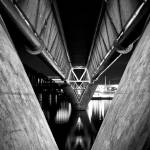 """Tempe Town Lake Light Rail Bridge at Night B&W"" by AlanTippins"