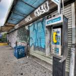 """Pay phone, graffiti, subway entrance, Hunters Poin"" by mgarbowski"