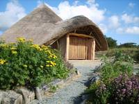 stoneage hut and herb garden