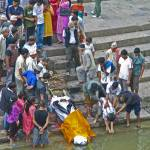 """Funeral rites on the Bagmati River, Pashupatinath"" by ChristopherByrd"