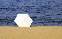 White Umbrella in the Sand