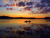 Canoeing on a lake at sunset