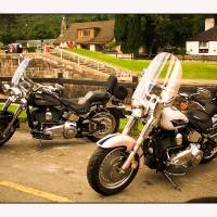 Harley couple at Fort Augustus Art Prints & Posters by Keith Raeburn