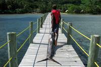 Fijian dragging a sailfin fish back from fishing