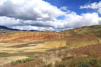 Painted Hills And Clouds