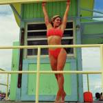 """Kim Hartt posing on Life Guard House"" by baechlergallery"