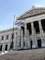 Uruguay National Flag and the Palacio Legislativo
