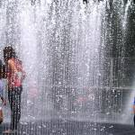 """Kids playing in Southbank Fountain"" by Izenhower"
