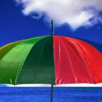_MG_1282_Umbrella by the sea Art Prints & Posters by John Rocha