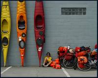 Girl with Bicycles and Kayaks
