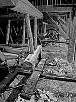 Hay Wagons in a barn BW