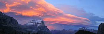 Panorama of sunset clouds in Glacier National Park