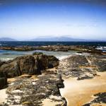 """Tasmanian beach rocks"" by kabe"