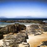 """Tasmanian beach rocks"" by kabe"