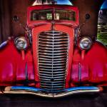 """Red Truck at Gateway Auto Museum"" by dennisherzog"