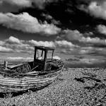 """Wrecked boat in dungenss black and white"" by georgefairbairnphotograph"
