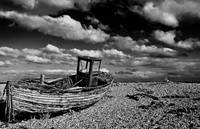 Wrecked boat in dungenss black and white