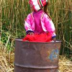 """girl on a trashcan at Titicaca lake"" by Maly"