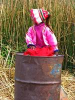 girl on a trashcan at Titicaca lake