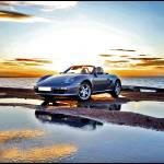 """Porsche Boxster at Sunset by the Sea."" by justhype"