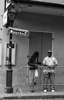 Two Guys Talkin on Bourbon Street in New Orleans
