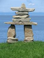 Stone totem facing the sea