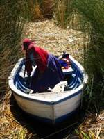Traditional peruvien woman in a boat