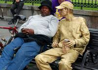 Napping guy with Gold Man on Bench in New Orleans
