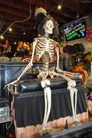 Skeleton drives carriage in New Orleans store
