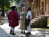 Shopkeepers in colonial Williamsburg catching up