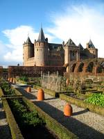 Gardens and medieval castle in autumn