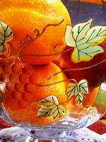 Fruit in an ornate bowl