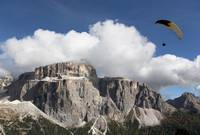 Paraglider and Monte Sella, Dolomite Mountains